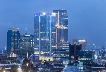 Aerial view of Jakarta business district at night in Indonesia.