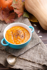 Picture of pumpkin soup in saucepan, spoons