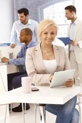 Happy businesswoman using tablet