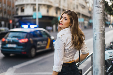 Stylish model standing at street