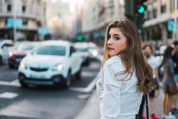 Stylish woman on crosswalk