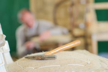 repairing a chair in a workshop