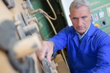 senior worker in his workshop