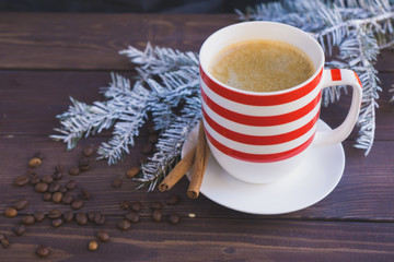 Cup of coffee and christmas fir branch