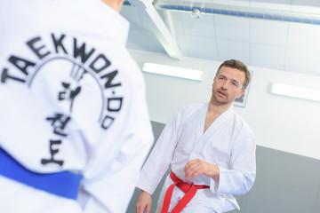 man training in a taekwondo class