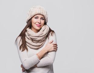 Beautiful woman winter portrait. Smiling girl wearing warm clothes