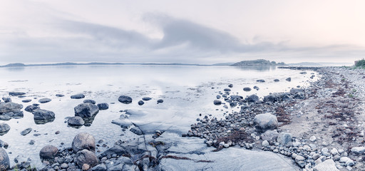 Panoramic landscape of Northern Sea coastline in Sweden. Morning scenery in fresh blue tone color.