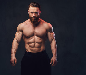 Portrait of bearded shirtless bodybuilder.