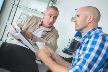 development contractor manager having a conversation