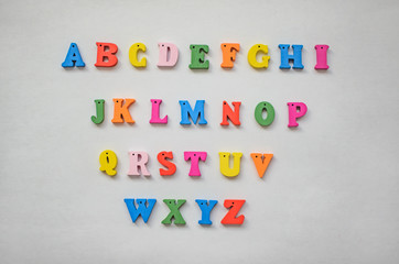 Multicolored letters of the alphabet on a white background