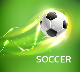 Flaming football or soccer ball flying with fire