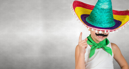 Funny  boy with a fake mustache Mexican sombrero.