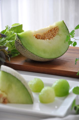 Piece of Honeydew Melon on Wooden Board