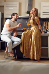 Photo of couple in love at kitchen with wine glasses with juice