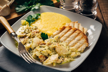 Codfish with polenta and bruschetta