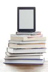 Picture of empty black picture frame on stack of books