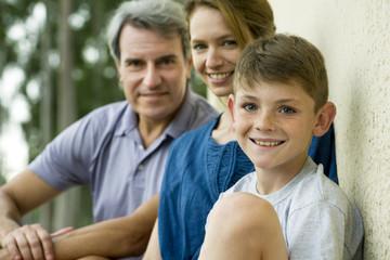 Boy with parents, portrait