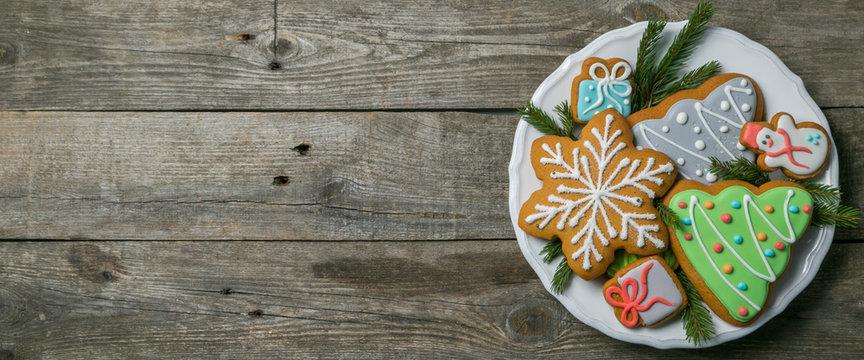 Christmas cookies on rustic wood background