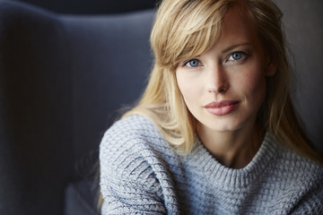 Stunning blue eyed blond woman looking to camera