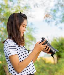 Portrait of asian beautiful girl using camera