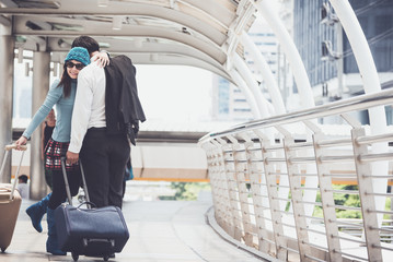 Couples who are falling in love, kissing  and embracing greet each other while waiting for your airport travel files.Concept of Traveler and lover