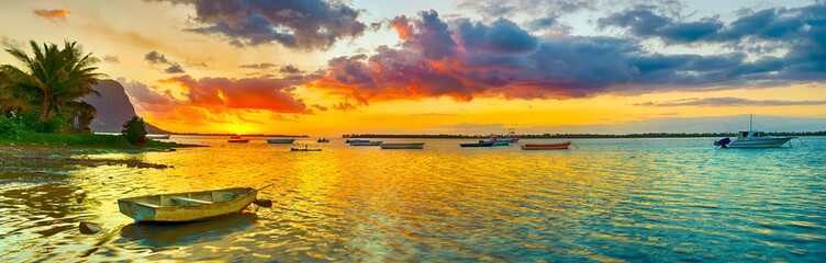 Printed roller blinds Island Fishing boat at sunset time. Le Morn Brabant on background. Panorama landscape