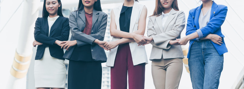 Group of business women holding hands support team. Coordinating of business unity in order to succeed in business,cooperation and teamwork business concept .
