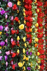 Colorful silk flower garlands in Vietnam market