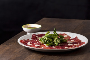 Carpaccio with a black background