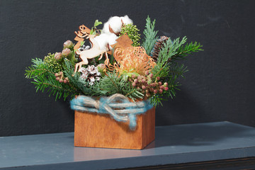 Cotton flowers and wooden reindeers in Christmas festive table decoration