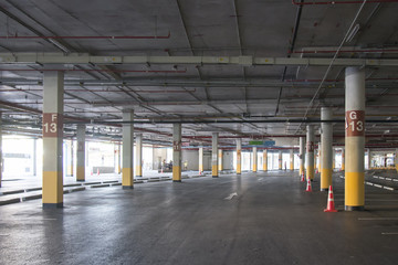 Empty Car parking garage underground interior in supermarket