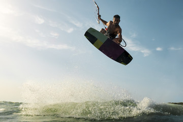 Surfer jumping in front of the camera
