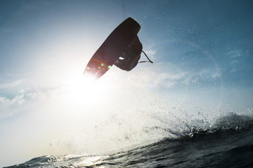 Surfer touching the sun