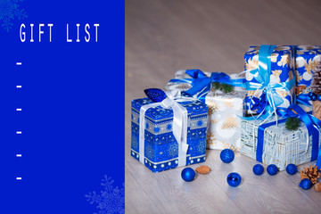 Christmas and New Year gift list with gift boxes and other festive decorations on the background
