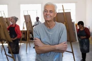 Portrait of senior man with crossed
