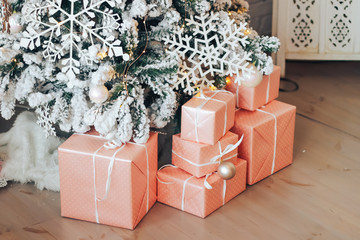 Christmas gifts under the Christmas tree in the room