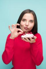 Beautiful women holding small cake. Birthday, holiday.