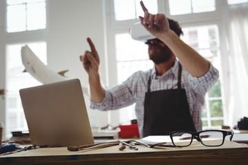 Craftsman using virtual reality headset