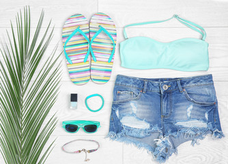 Composition with mint clothes and accessories on light background