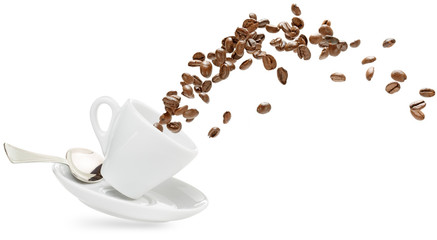 coffee beans spilling out of a cup isolated on white