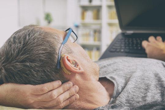 Hearing impaired man using laptop