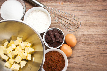 Bakery ingredients. Ingredient of brownie on wooden background. Top view with copy space.