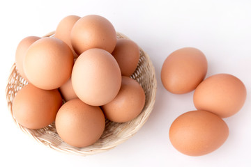Top view Eggs in the basket on White Background