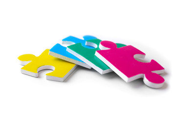 Puzzle pieces on white background as symbol of autism