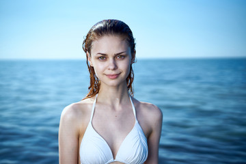 Beautiful young woman is resting on the sea, summer, ocean, beach