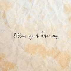 Follow your dreams on old crumpled paper