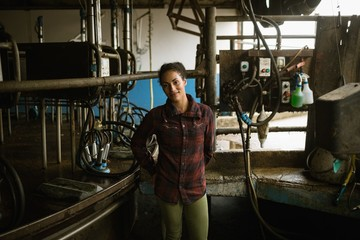 Confident woman standing in barn