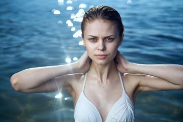 Beautiful young woman on vacation at sea, ocean, beach