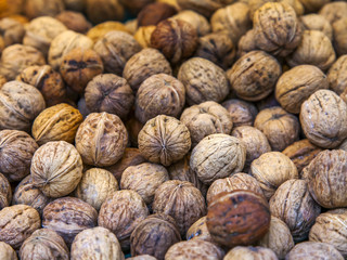 Walnuts are laid out on a counter of shop