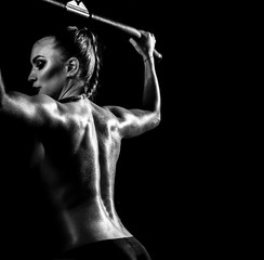 fitness woman execute exercise on black background